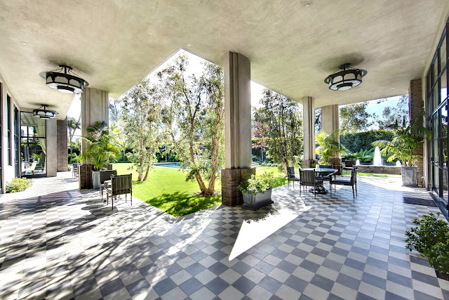 Covered patio grey and white checkerboard floor pool metal outdoor furniture