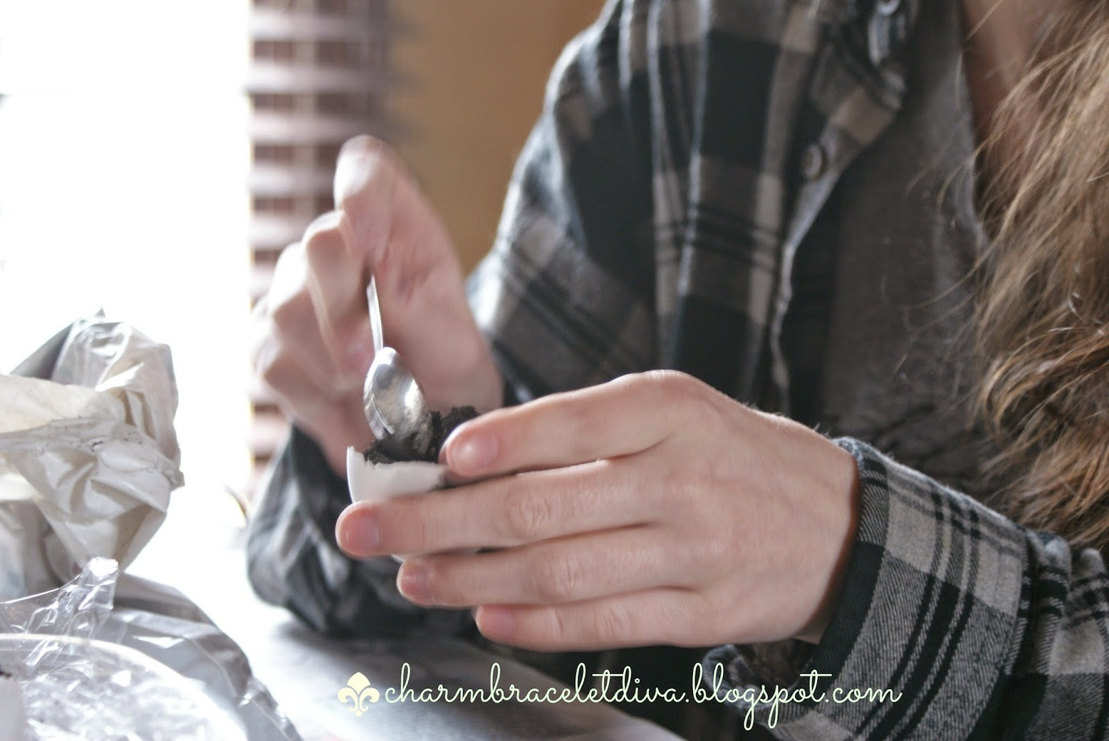 hands spooning dirt into egg shells