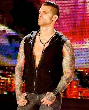 Beefcakes of wrestling tattoos and 39 tude for Corey graves tattoos