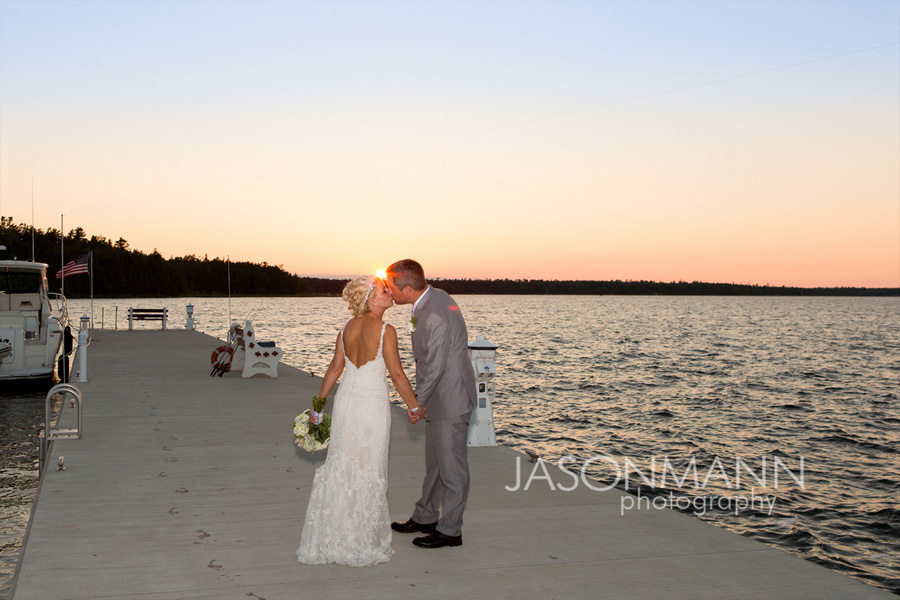 Door County wedding, sunset kiss at Gordon Lodge. Photo by Jason Mann Photography, 920-246-8106, www.jmannphoto.com