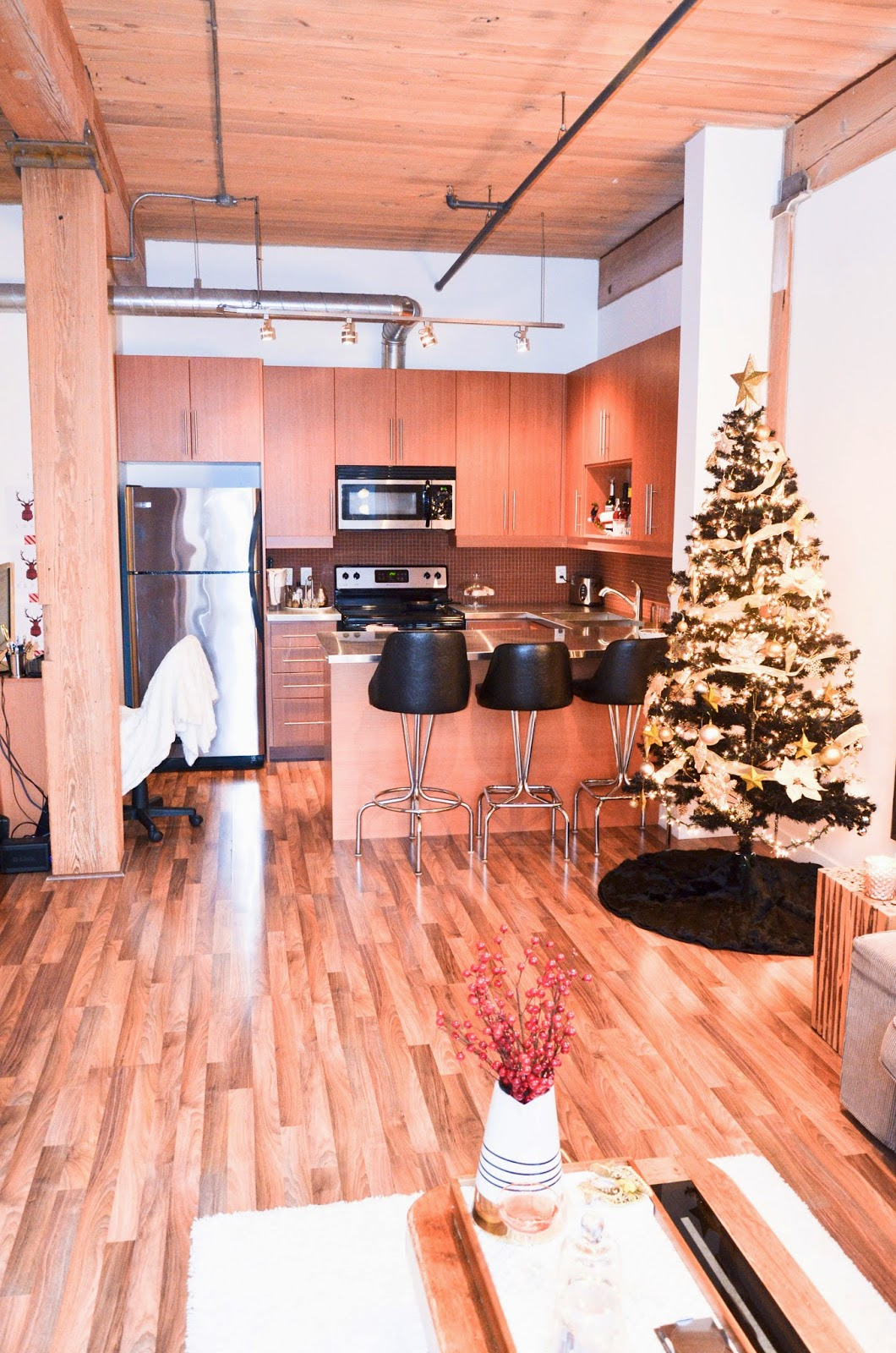 HOME DECOR: black and gold christmas tree in a Rustic Facotry converted Loft in Toronto