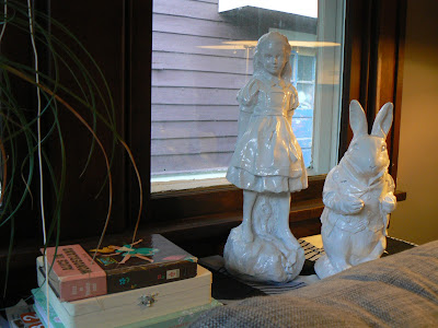 mylittlehousedesign.com alice in wonderland faux ceramic statues