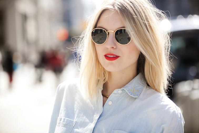 Ray-Ban Lenon round sunglasses, MAC Lady Danger lipstick, Madewell monogrammed chambray shirt
