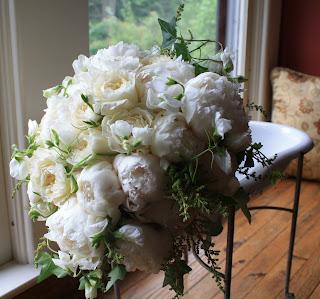 "Bowl of Cream peony, tender white sweet peas, white astilbe, David Austin ""Patience"" garden roses, and English ivy bridal bouquet - Otesaga Resort - Splendid Stems Floral Designs"