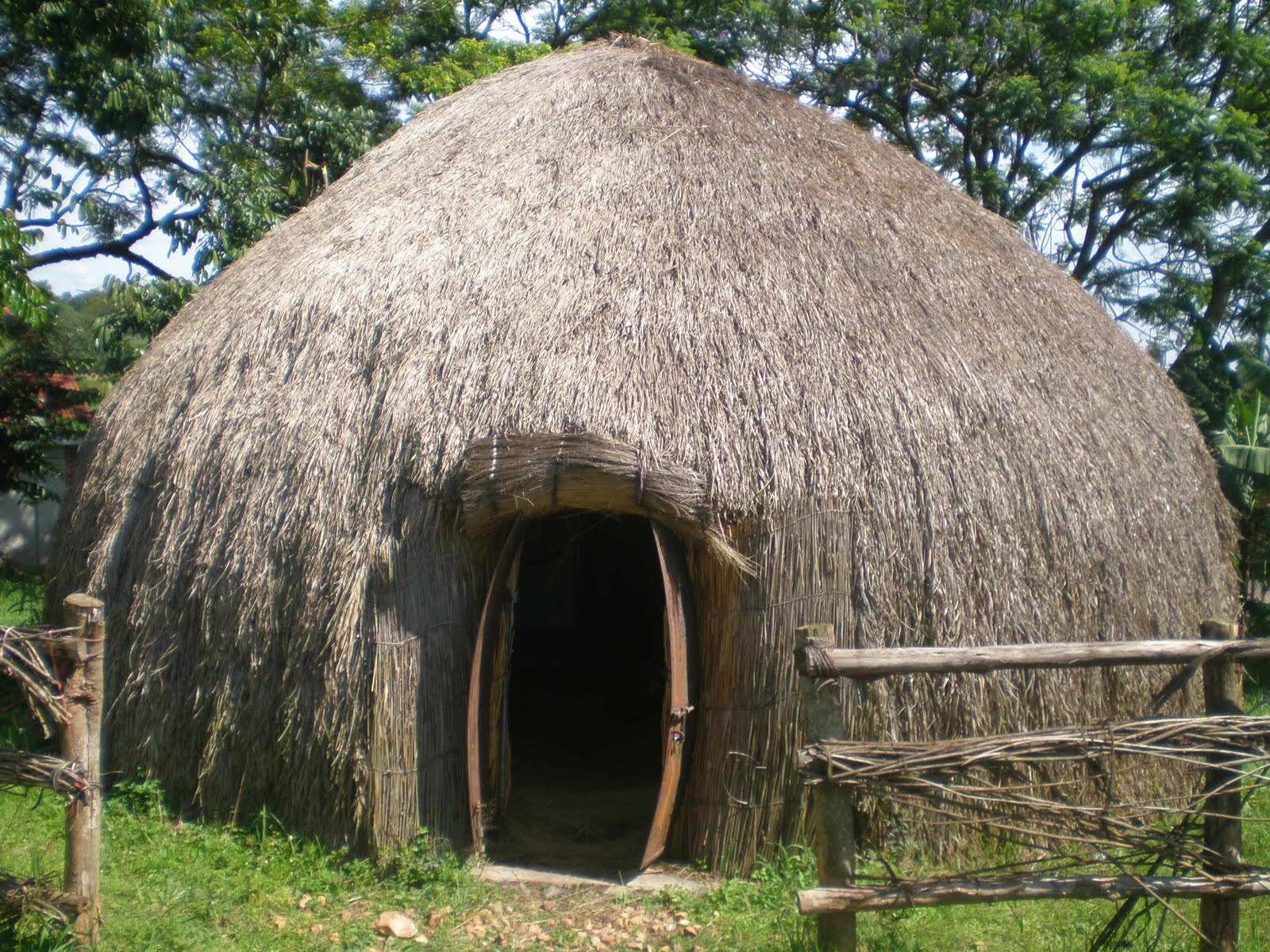 Uganda heritage pride traditional houses west for Conventional homes