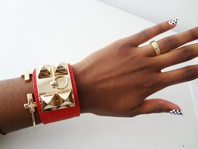 Gold Pyramid Stud Faux Leather Cuff Bracelets red on wrist.