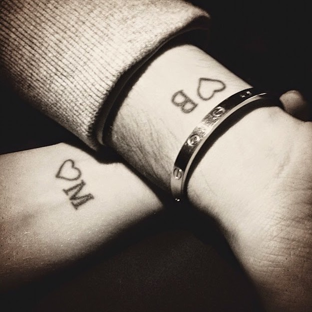 Heart or name matching tattoos for couples