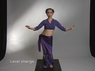Azhia demonstrates how to change bellydance movements with level change