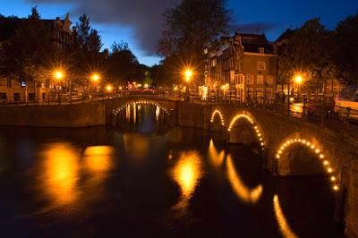 """Amsterdam - Lights along canal bridges along Herengracht near the famous """"Golden Bend"""""""