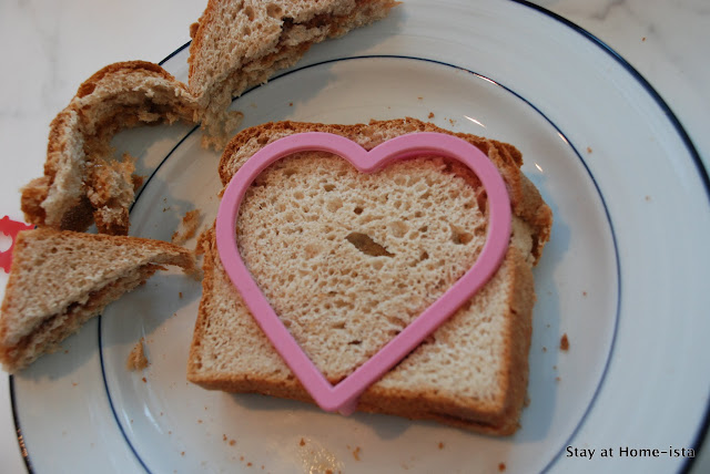 use a cookie cutter to create a heart shaped sandwich for valentine's day school lunch