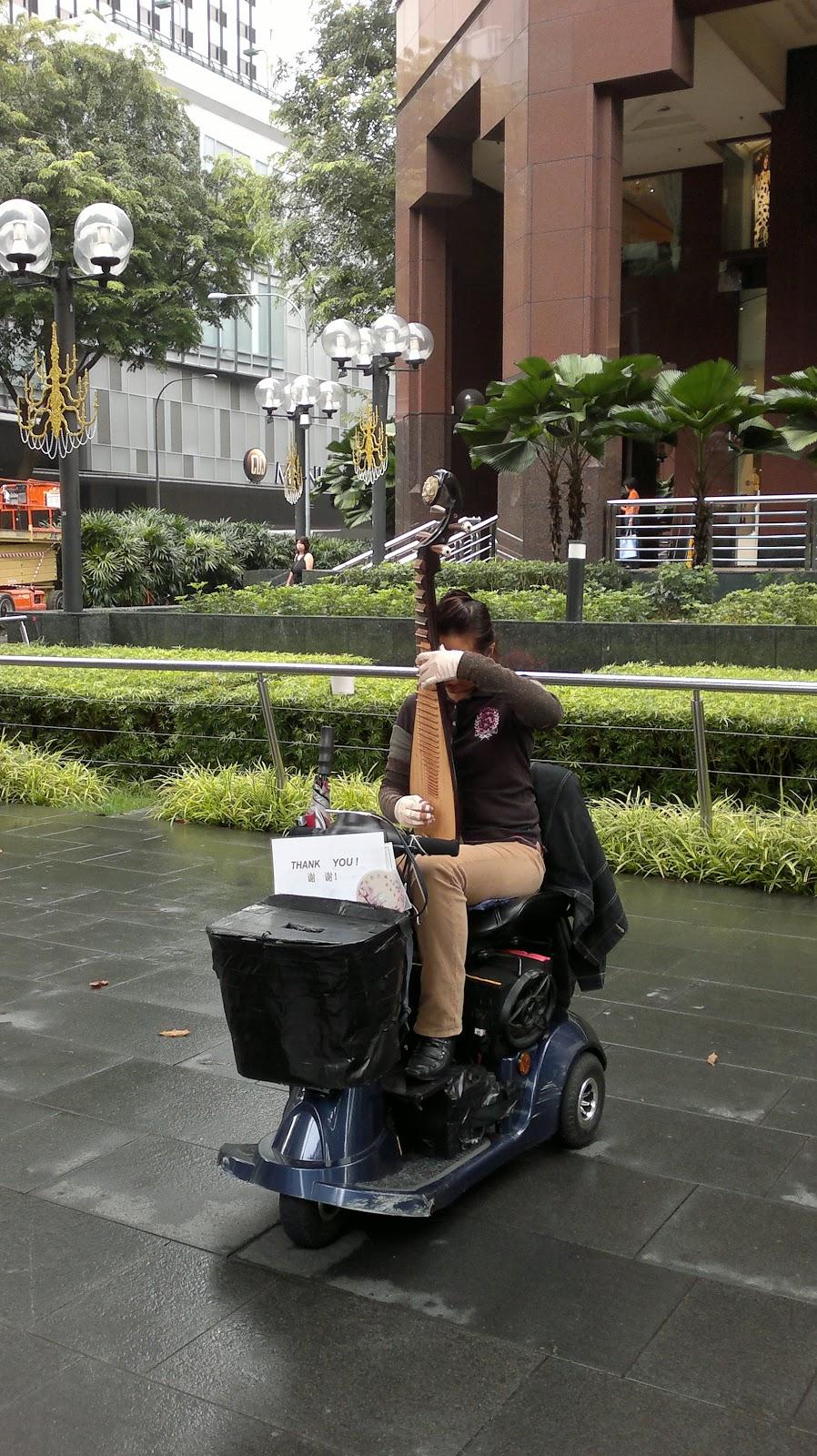 Orchard Road - street Artist