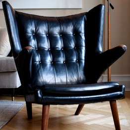 Delicieux Another View Of The Black Leather Hans Wegner Chair Owned By Elie Tahari.  The Fashion Designer Paid Between $8,000 And $12,000 For This Papa Bear.