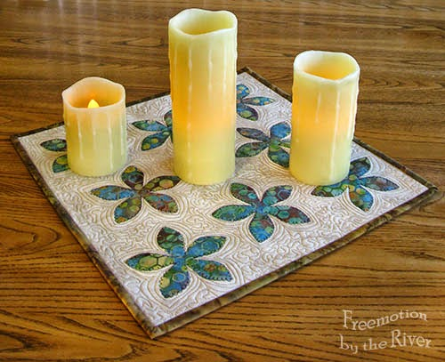 3 candles on mat
