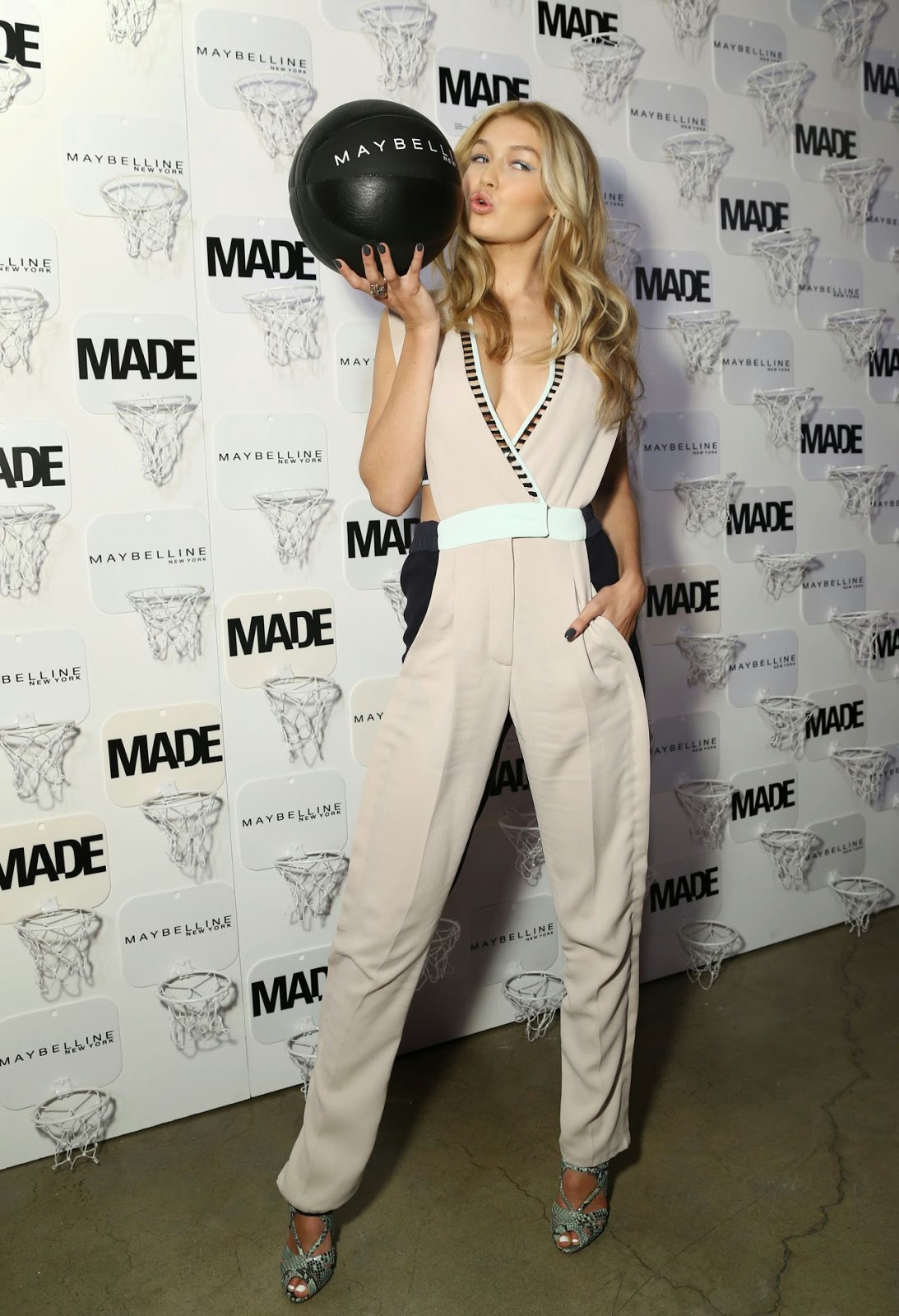 Gigi Hadid in a low-cut jumpsuit at the Made x Maybelline NY Tip-Off Party