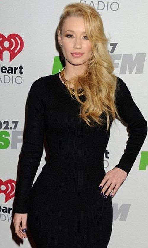 It's no wonder Iggy Azalea just wanted to sit back, relax, and enjoy a tasty business.  Which is exactly what the Australian brunette did at Los Angeles, USA on Saturday, December 6, 2014.  The 24-year-old spotted looking beauty in a dark dress while entering the red carpet on the KIIS FM Jingle Bell Ball.