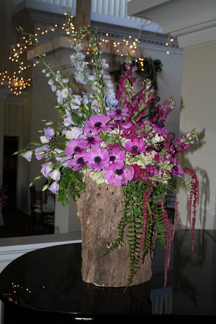 Large Floral Arrangements in Hollow Tree Stump - Splend Stems Floral Designs