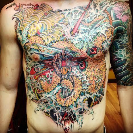 Half body tattoo of sea monster by tattoo artist Jason Kunz for Triumph Tattoo