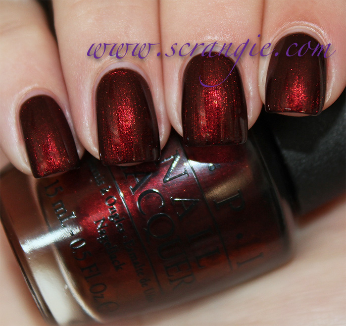 opi german icure by opi a dark vampy brown tinged shimmery red looks    Opi German Icure