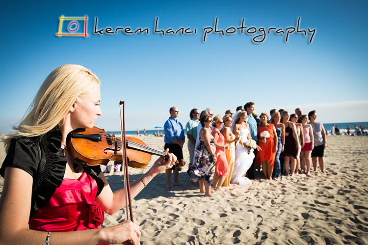 The live violin provided a soothing and peaceful soundtrack to this gorgeous beach wedding