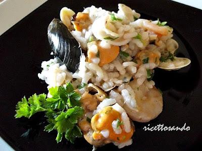 Risotto allo scoglio ricetta classica di un primo piatto ricco di pesce