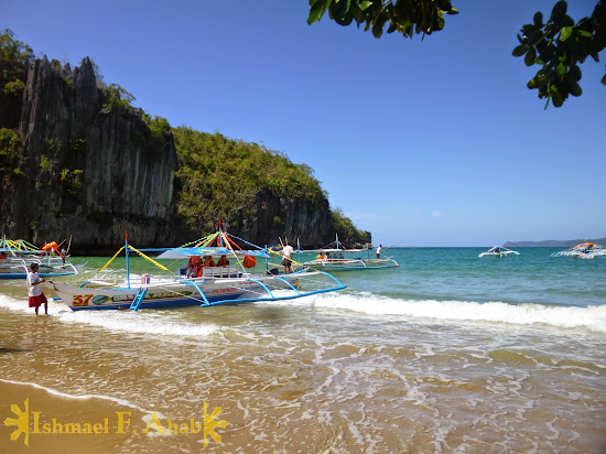 Pulling the boats to the beach of the Puerto Princesa Underground River National Park
