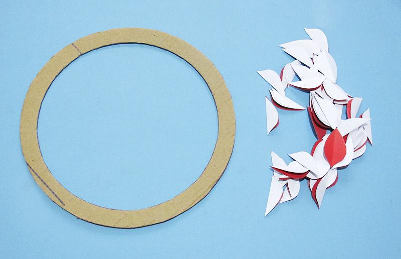 Como fazer uma guirlanda de natal feita com papel