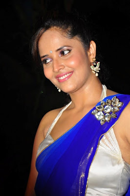 glorious hot exotic Anchor anasuya sexy in blue saree