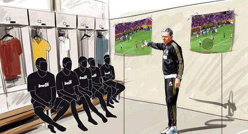 Mourinho talking to his player at the locker room