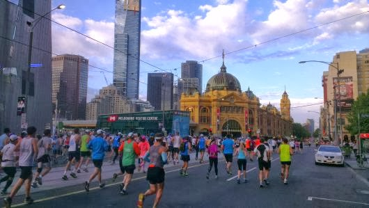 Running down Flinders Street towards the iconic Flinders Street Station