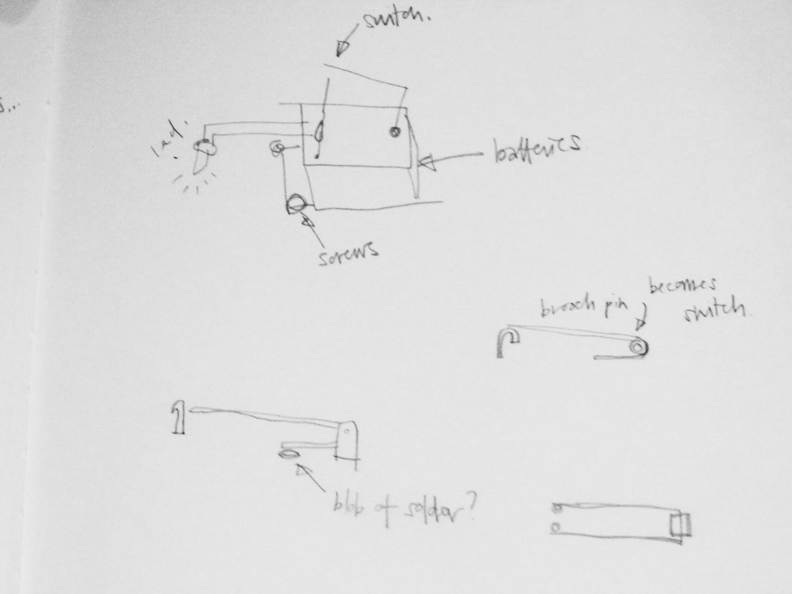 A glimps at a sketchbook which shows some diagrams of how to make a brooch pin into a switch for an eletrical circuit,