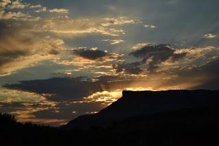 Sun setting behind plateau