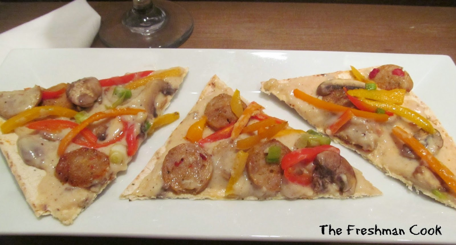 Flatbread appetizer with sausage and mushroom