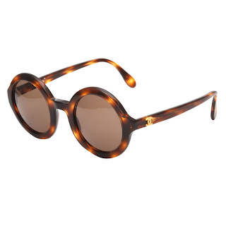 Vintage 1990's brown tortoise round Chanel sunglasses with gold hardware.