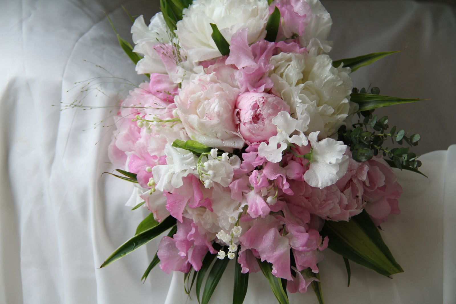 soft and blousy gentle and romantic pink and ivory wedding bouquet