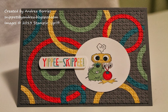 Gray card with red, yellow, blue and green circles on the background and an image of three friendly monsters.