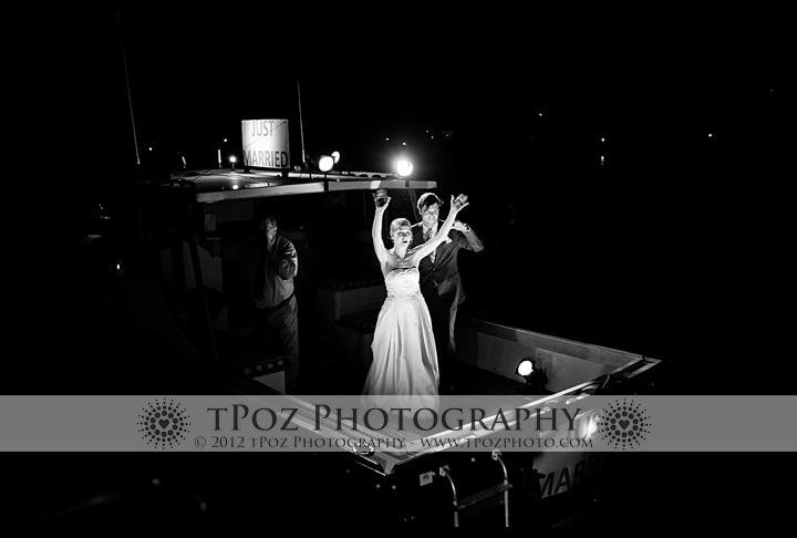 Bride & groom leave by boat