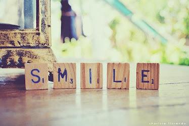 S M I L E.