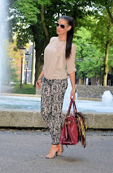 Lace pants and a burgundy bag
