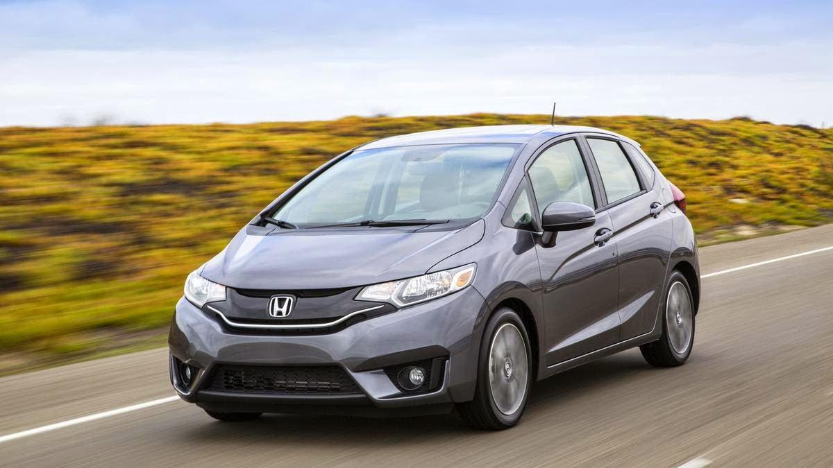 "HONDA'S FIT IS INDEED A LITTLE MORE FUN WITH A MANUAL  ASSOCIATE EDITOR GRAHAM KOZAK: Hmm. I'm torn. I look back at my notes for the CVT-equipped version of the 2015 Honda Fit EX and seemed to like it. It feels plenty big inside without growing all that much when compared to its predecessor. It's not bad to drive, and it doesn't cost an arm and a leg. But this six-speed Fit didn't quite live up to its potential as an affordable, practical, fun hatch.  The bundling of features is frustrating. Want a manual-equipped car with navigation? Can't let you do that, Dave, never mind that this car seems to have the same head unit as more luxe versions. That's not a Honda-only thing by any means, though, so I can't really hold it against the Fit.  Thing is, this car just isn't as taut as I was hoping it would be. From the sloppiness of the shifter to the soft clutch, I feel like this could be tighter, sportier.  Honda -- you know the masses aren't exactly snapping up manual-equipped cars. Far from it. So cars with sticks appeal to a certain subset of the driving population -- why not give 'em what they want, which is a more engaging all-around driving experience?  I'm not asking for a Honda Fit Si (although…maybe I am?); 130 hp is plenty. Still, I feel like the fun, cheap Mazda 2 wouldn't be such a bad vehicle to emulate when it comes to suspension and input feel.  Don't get me wrong: This stick-equipped version is more fun to drive than the competent CVT version, but I'm not finding this to be much more compelling than a comparable Nissan Versa.  And that's really too bad, because right now, it's a good little car that could have been a great little car.   2015 Honda Fit EX front right  The 2015 Honda Fit EX comes in at a base price of $18,225. SENIOR ROAD TEST EDITOR NATALIE NEFF: I have to echo Graham's thoughts, but only to a point. He's right; this car certainly didn't live up to its potential as an affordable, practical, fun hatch. But I'd argue it's every bit the affordable, practical hatch it set out to be. Manual tranny or not, I can't think that Honda had any intention for this Fit to be fun.  As enthusiasts, we have the tendency to project the notion of fun on anything with a stick, and certainly if that shift-it-yourselfer is a hatchback, all the more proof said car should be a funmobile. It's an inherent flaw in the way American enthusiasts interpret the automotive world. Where a European of modest means might look at a subcompact hatchback with a stick and see ""affordable transportation,"" we see ""hot hatch."" The fact that this car is by no means fun is not a fault of the car but of our expectations.  There's just no evidence that fun was anywhere in the thinking when this car was penned, built or sold. Between its mediocre 130-hp four-banger, 37-mpg freeway rating, bare-bones technology features and power moonroof, this EX model really represented a midlevel package aimed at folks who don't care about things like hands-free connectivity but still desired a basic suite of comfort features in their ride.  I absolutely appreciate that the Fit still arguably boasts the most flexible interior in all of cardom. It's one of the most important features I look for in a vehicle, car or truck. I also tend to favor smaller over bigger, so a car with this footprint AND this level of utility is a major bonus in my book. But at the end of the day, I still want SOME fun in the equation, too."