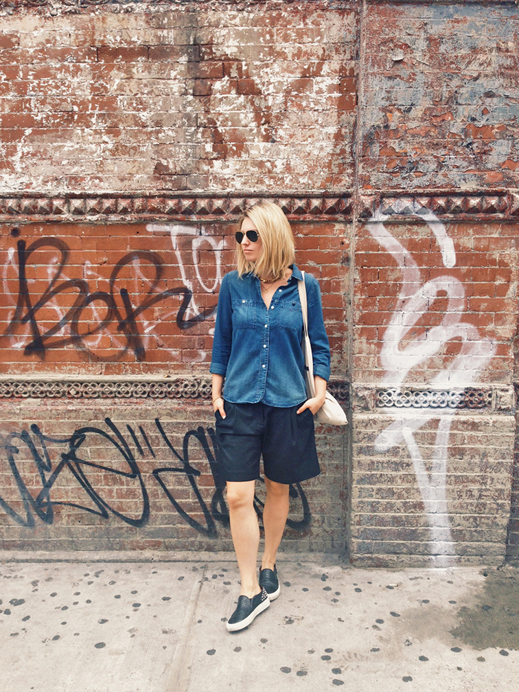 Denim shirt, Madewell jean shirt, black Tibi culottes, bermuda oversized shirts, leather slip-on sneakers, New York City streets, Lower East Side