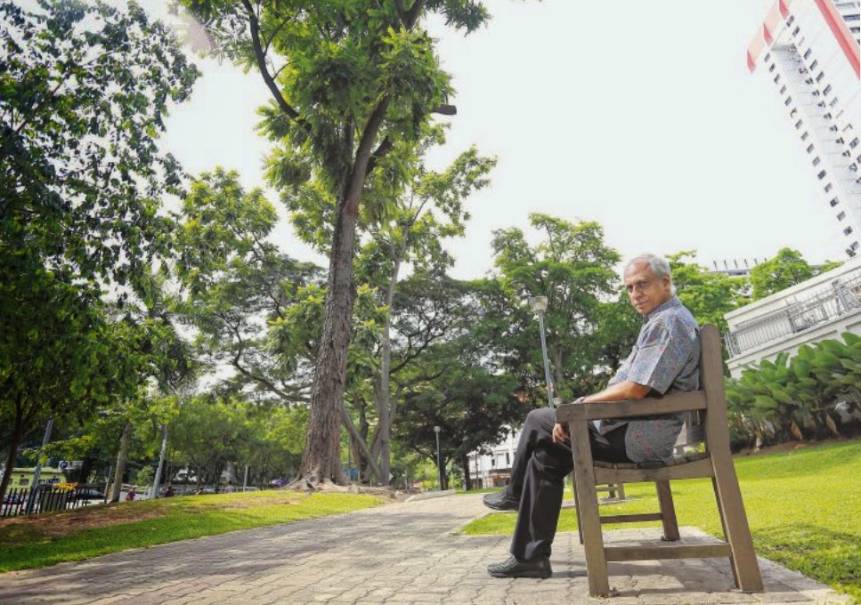 ONE DOWN... : Mr Ismail sitting near the chittagong tree planted by Mr Lee in 1983. The My Paper reader found the tree at the Duxton Plain Park.