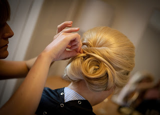 Girl having her hair styled for her wedding with pin curls and volume