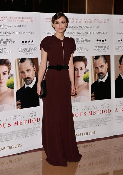 "The 'Pirates of the Caribbean' star Keira Knightley in an elegant backless vintage style floor-length merlot gown by British fashion house Burberry with puff sleeves, gathering at the collar and a deep neckline and sporting a chic retro style up-do in very subtle finger waves with a loose bun at the ""A Dangerous Method"" UK Gala film premiere held at The Mayfair Hotel on January 31, 2012 in London, England."