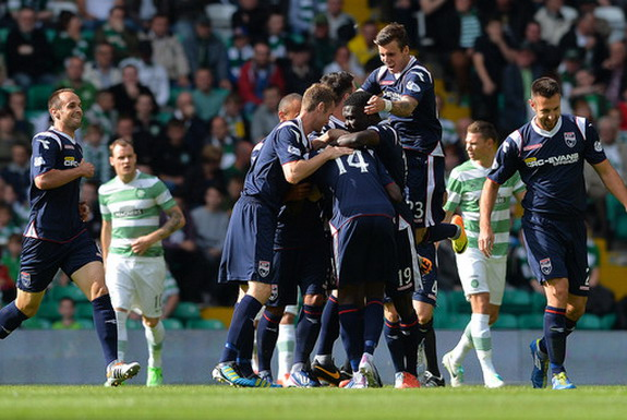 Darren Maatsen is mobbed by Ross County teammates after scoring a goal against Celtic
