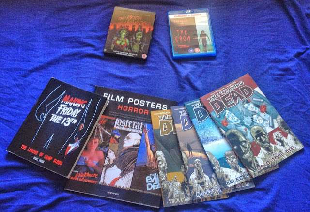 two blurays two books and four graphic novels