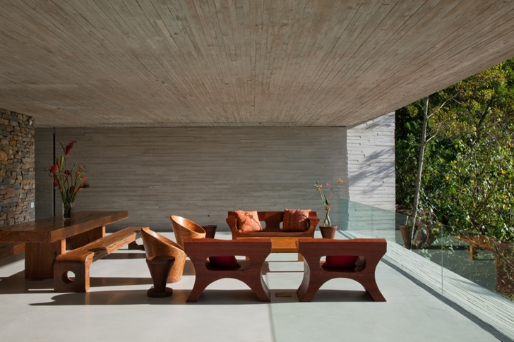 Wooden furniture in Modern beach house in Brazil by Marcio Kogan