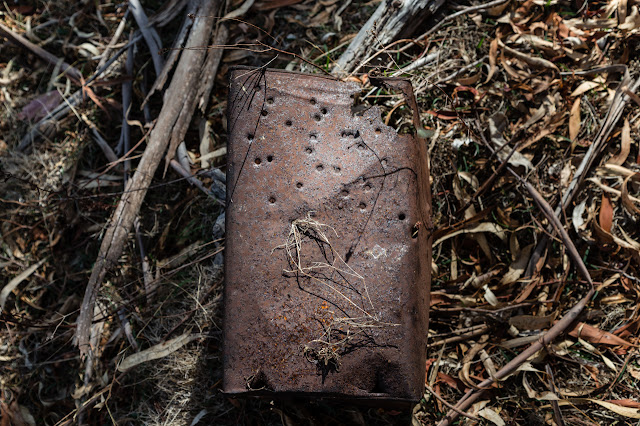 old tin can with bullet holes