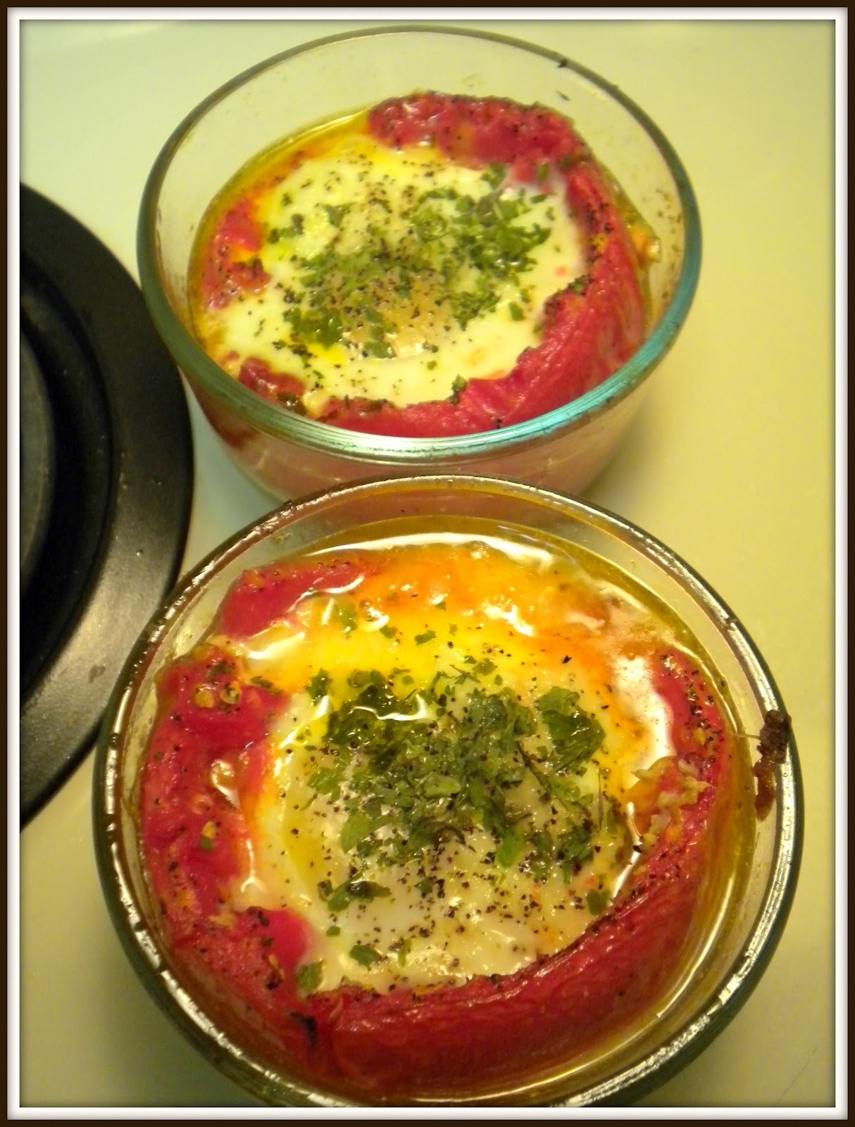 a girl eats world: Baked Egg in Roasted Tomato Cups