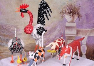 folk art from lonnie  and twyla money from london ky showing a guinea hen and chicks a large rooster a red fox and a small chicken
