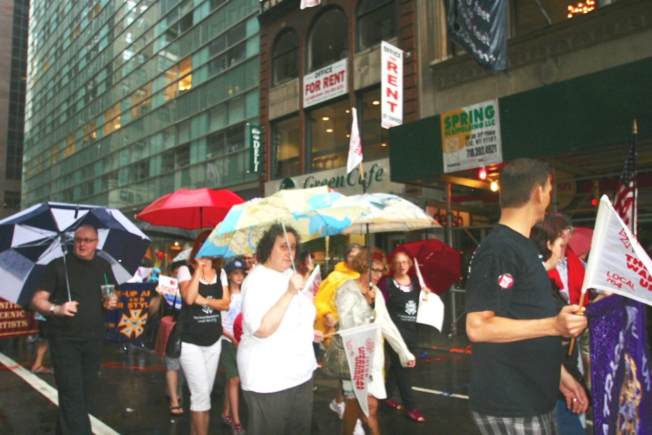 broadcast union news iatse members turned out in force for the iatse local 764 theatrical wardrobe union members proudly behind their banner umbrellas held high